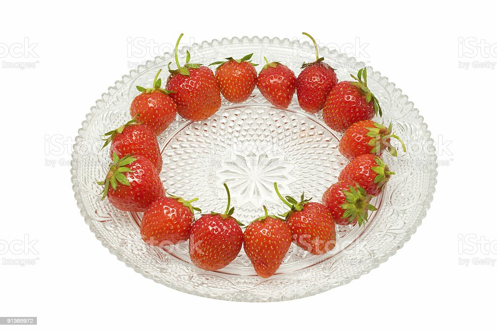 Strawberries on glass dish, isolated upon white, with clipping path stock photo