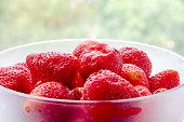 Strawberries on green. Strawberries in bowl. Healthy strawberries.