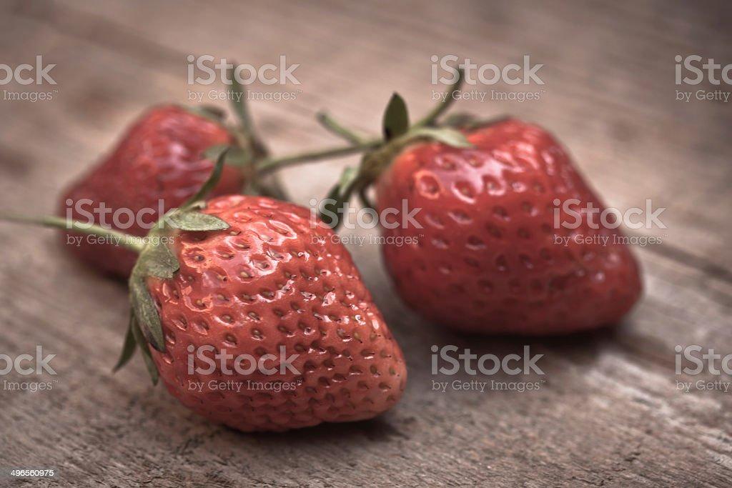 Strawberries on wood stock photo