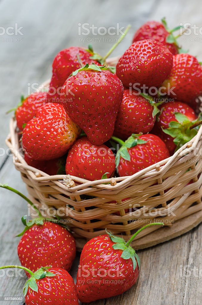 Strawberries on wooden background stock photo