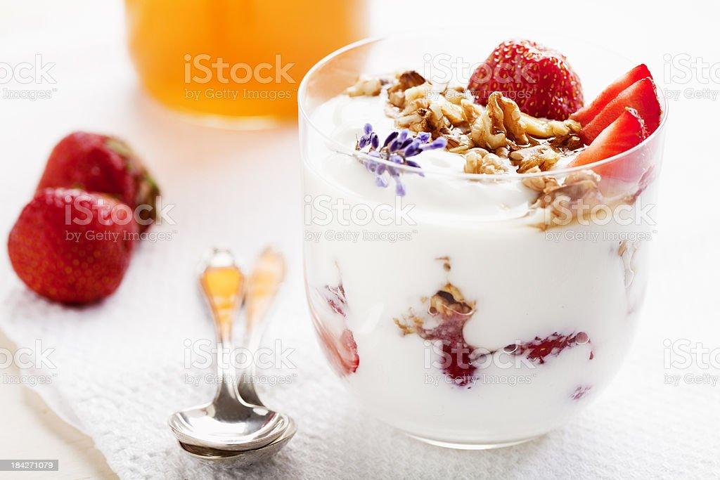 strawberries, walnuts and yoghurt stock photo