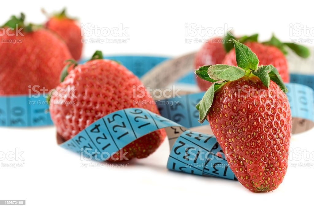 Strawberries with a measure tape royalty-free stock photo