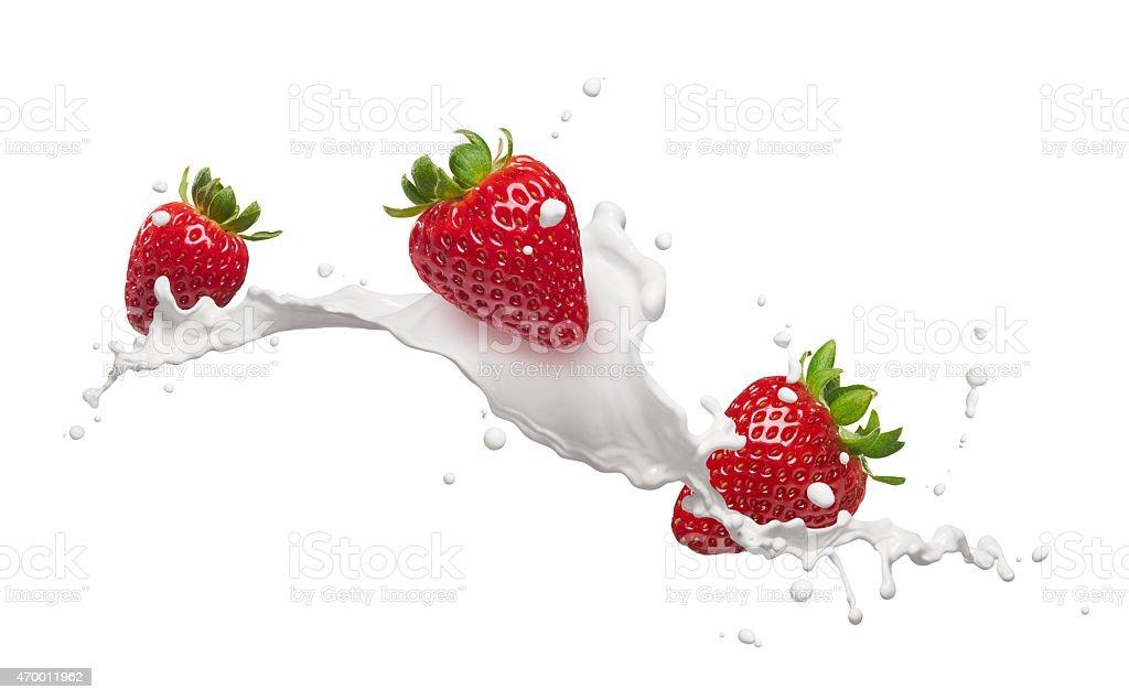 strawberries with milk splash stock photo