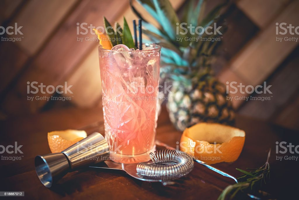 strawberry alcoholic cocktail with lime and orange stock photo