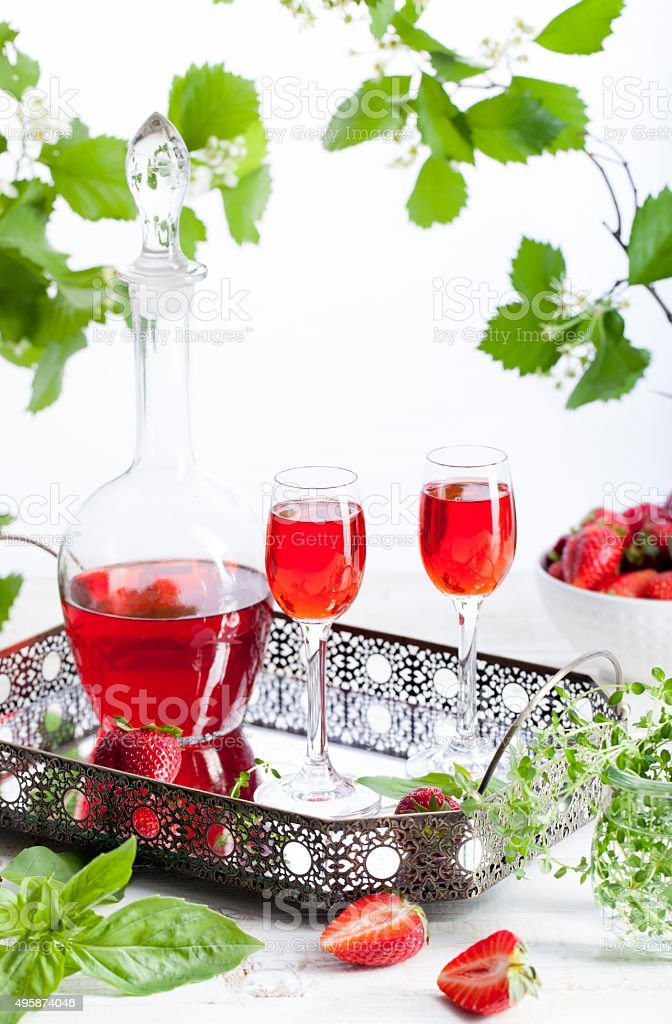 Strawberry and basil homemade liquor on a white background stock photo