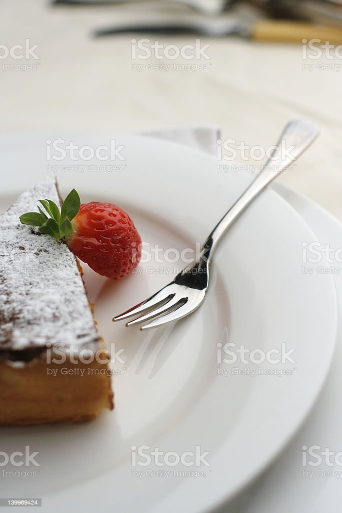 Strawberry and Chocolate dessert with fork; tall view Shallow DoF royalty-free stock photo