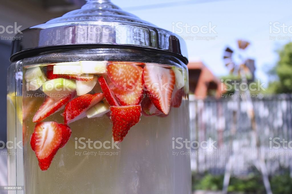 Strawberry and Cucumber Water in Glass Jug stock photo
