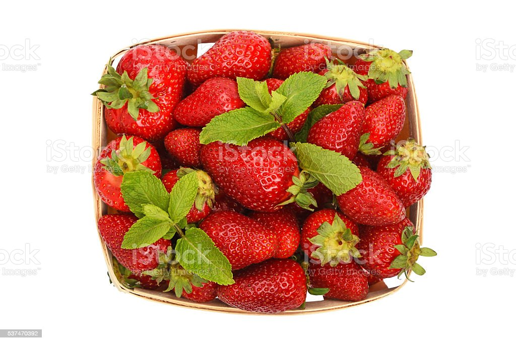 Strawberry and mint in basket isolated on white stock photo
