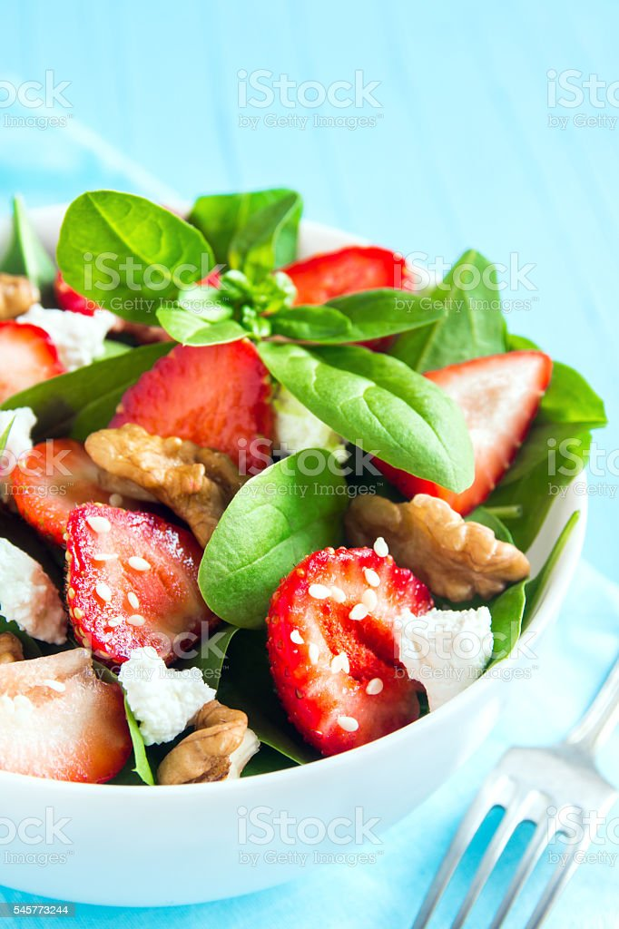 Strawberry and spinach salad stock photo