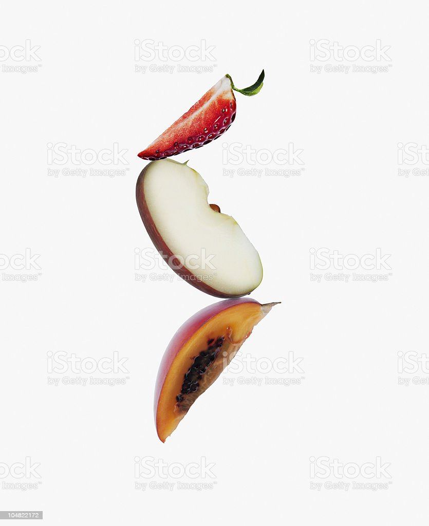 Strawberry, apple and tamarillo wedges stock photo