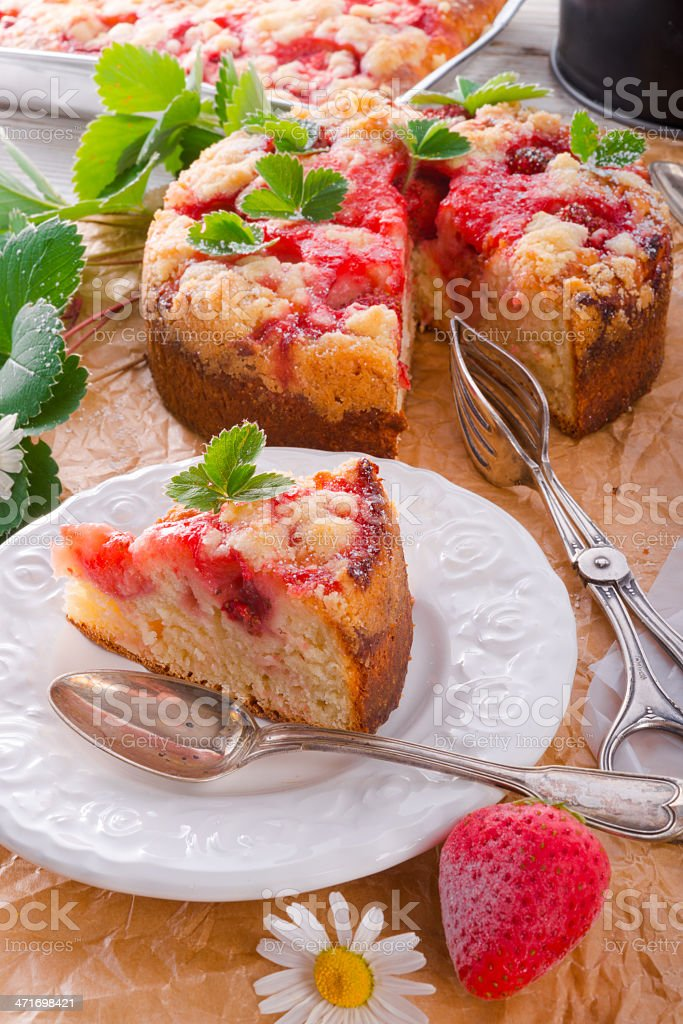 Strawberry buttermilk cake with pistachios stock photo
