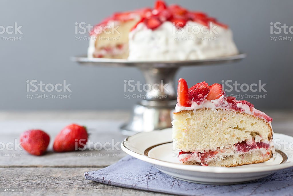 strawberry cake on the cake stand stock photo