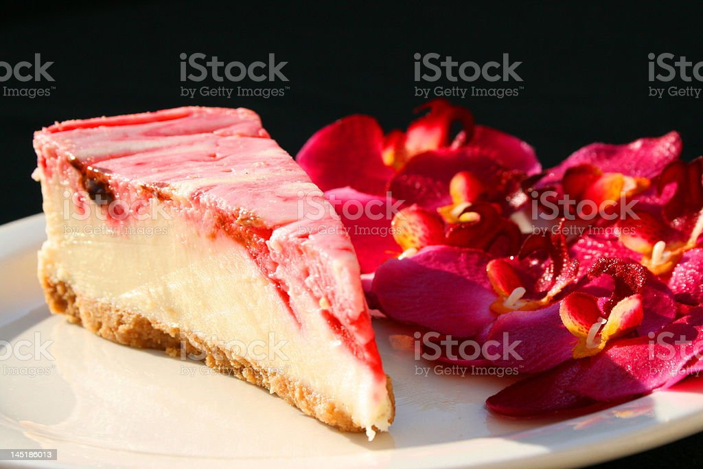 Strawberry cheesecake and orchids royalty-free stock photo