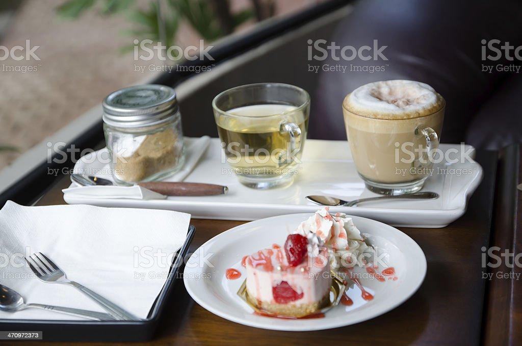 strawberry cheesecake and set of cappuchino royalty-free stock photo