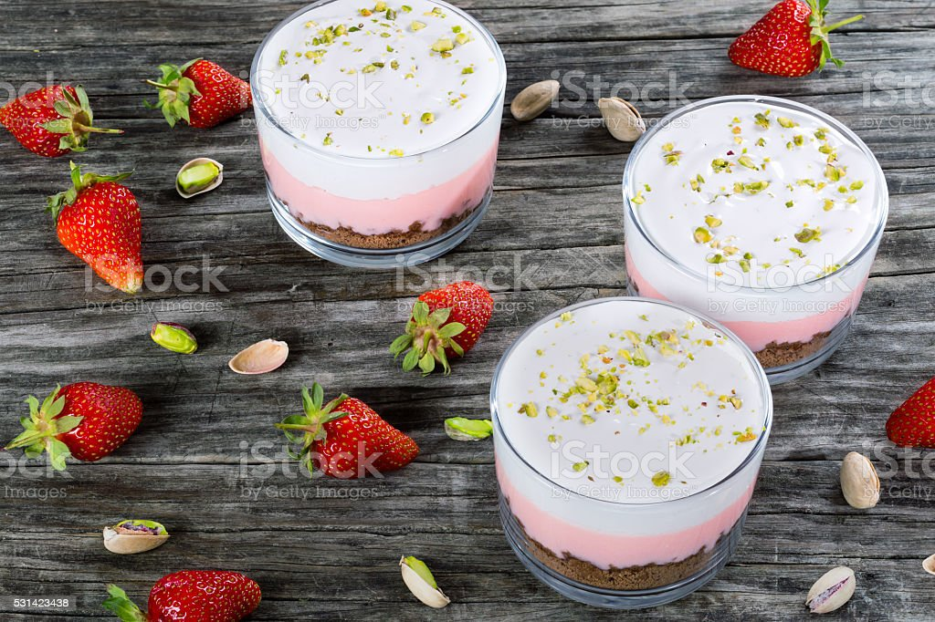 Strawberry Cheesecake Mousse Cups decorated by egg white cream f stock photo