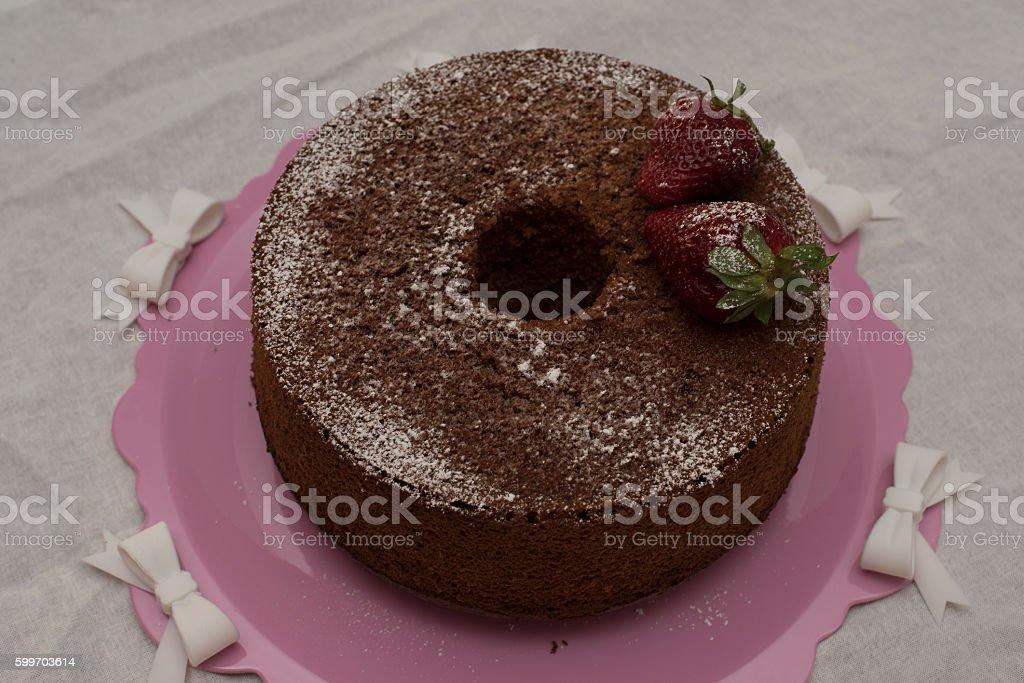 strawberry chiffon cake with cocao powder. stock photo