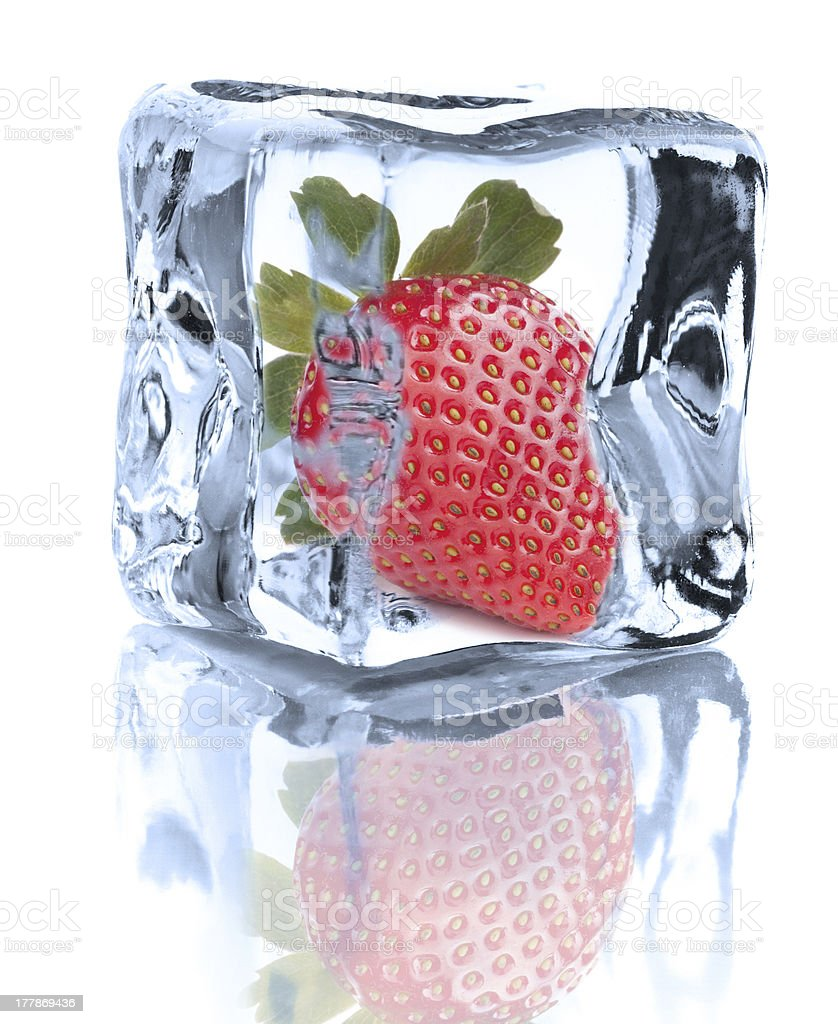 Strawberry chilled in Ice cube  on white background royalty-free stock photo