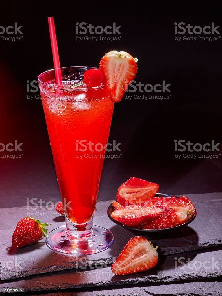 Strawberry cocktail with straw in highball glass stock photo