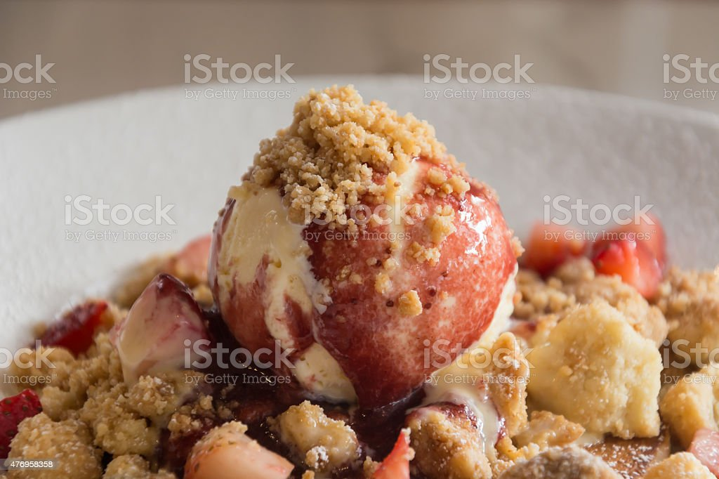 Strawberry Crumble Pancake on plate stock photo