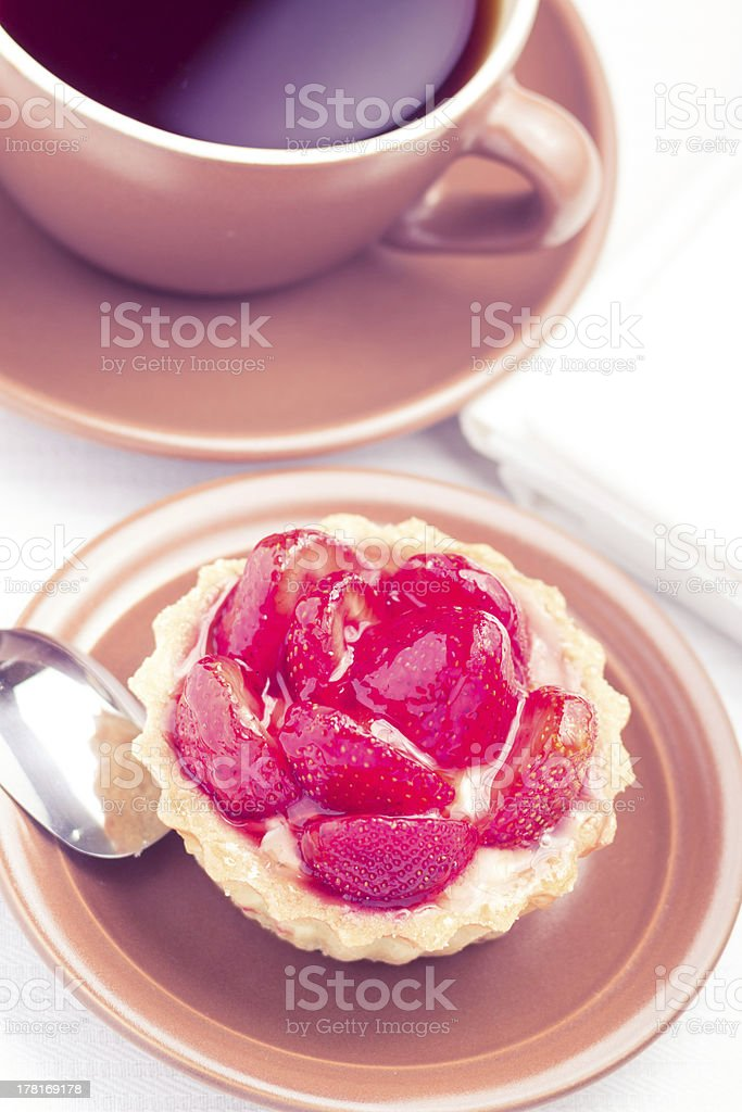 Strawberry dessert in Waffle Basket with Cup of Hot Tea royalty-free stock photo