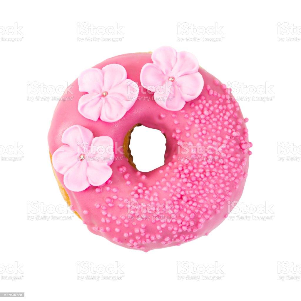 Strawberry donut with pink glaze, decorative sprinkles and flowers stock photo