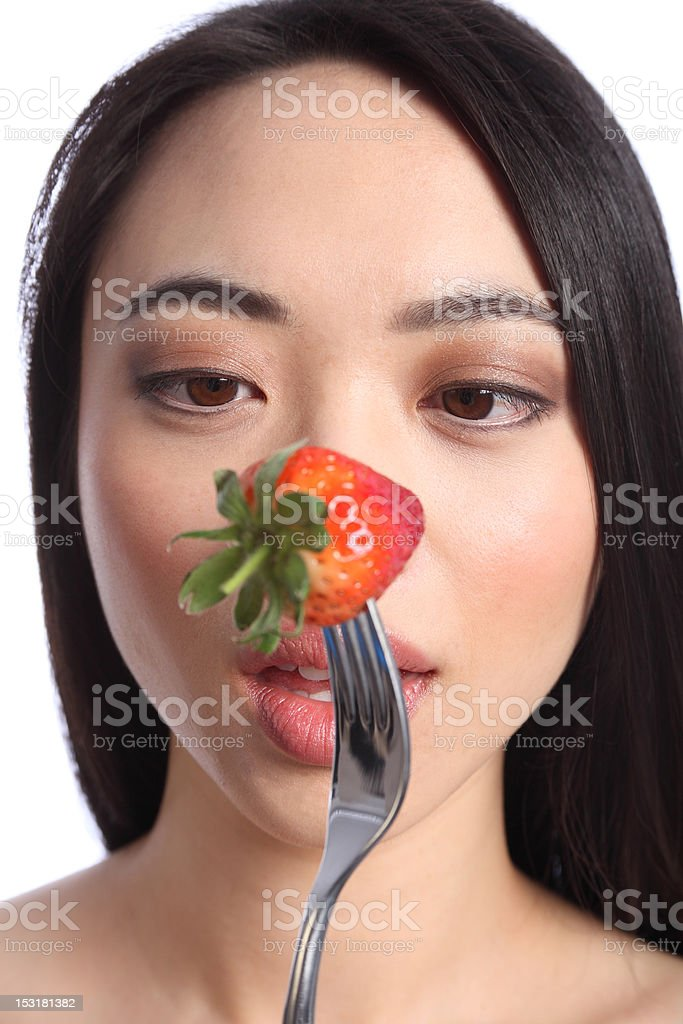 Strawberry eyes of beautiful young oriental girl royalty-free stock photo