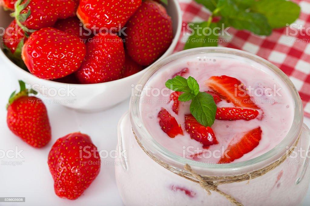 Strawberry flavored yogurt with fresh berries stock photo