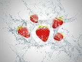 Strawberry fruit in splash