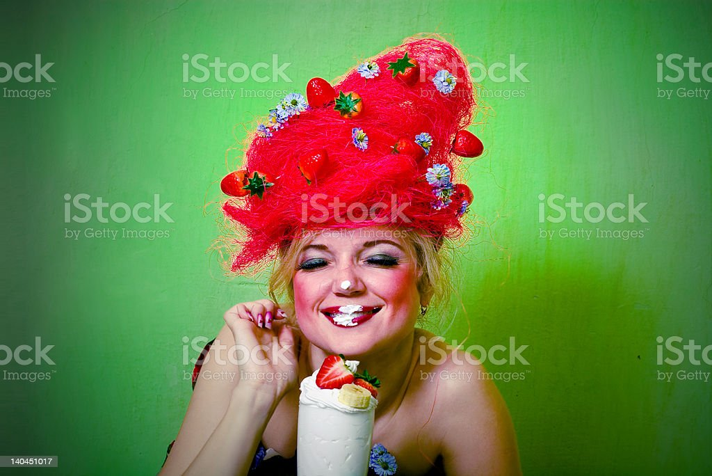 Strawberry girl eating whipped cream royalty-free stock photo