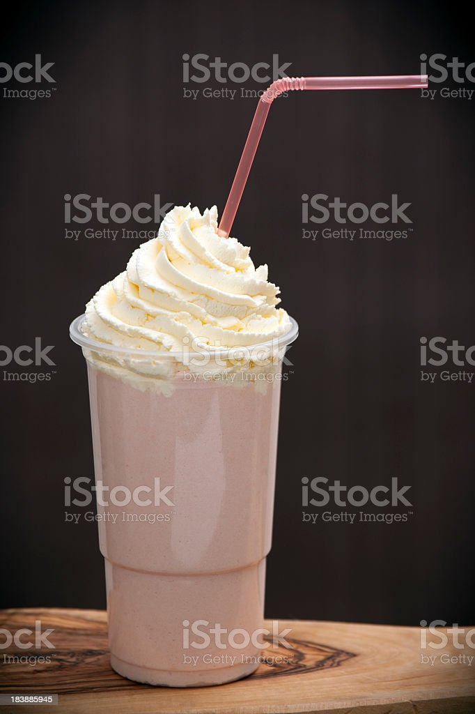 Strawberry iced blended summer drink topped with cream royalty-free stock photo