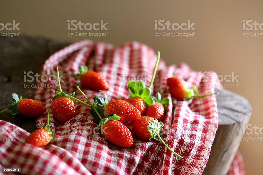 Strawberry in fabric background stock photo