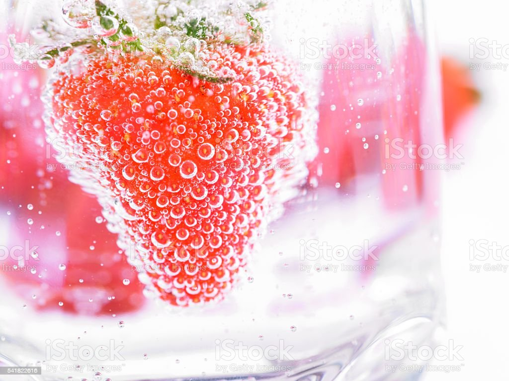 Strawberry in Mineral water with boobles stock photo