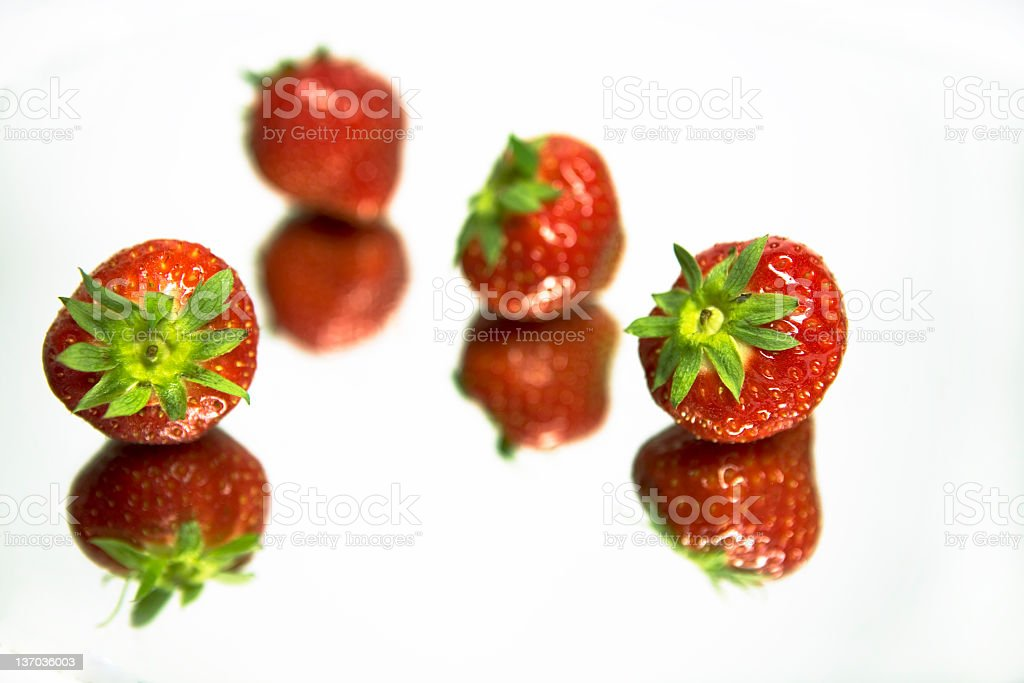 strawberry in mirror stock photo