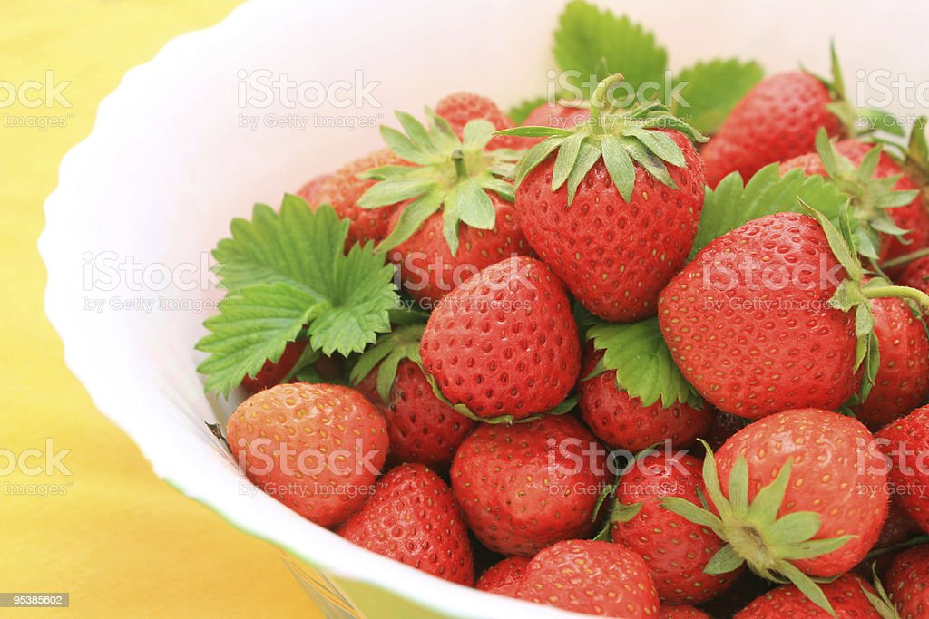 strawberry in plate stock photo