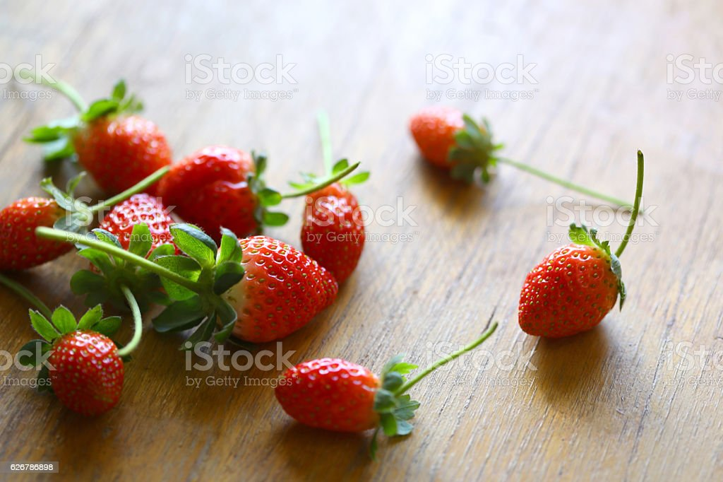 Strawberry in plywood background stock photo