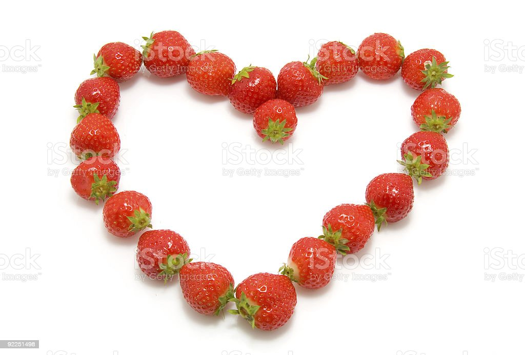 strawberry in shape of heart stock photo