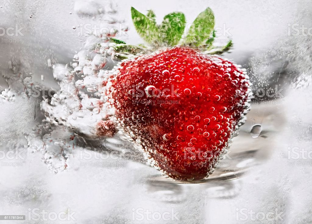 Strawberry in water with bubble stock photo