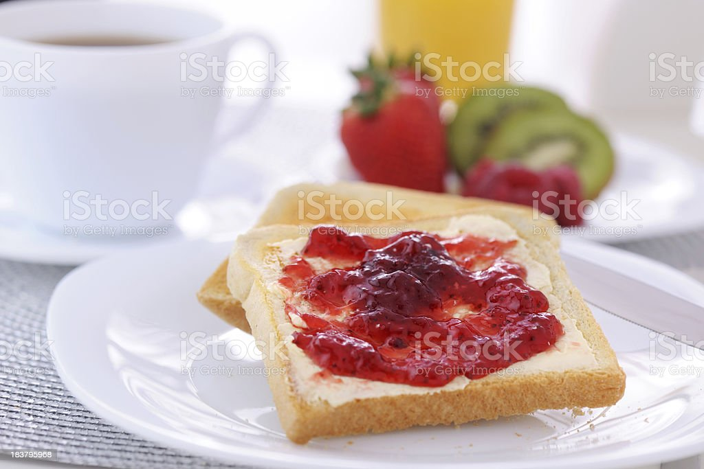 Strawberry jam and bread stock photo