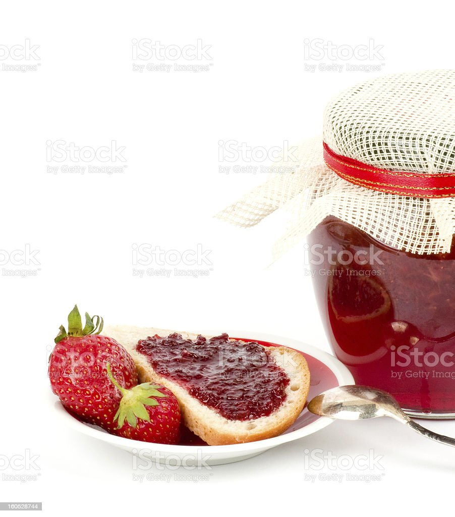 Strawberry jam and toast on white royalty-free stock photo