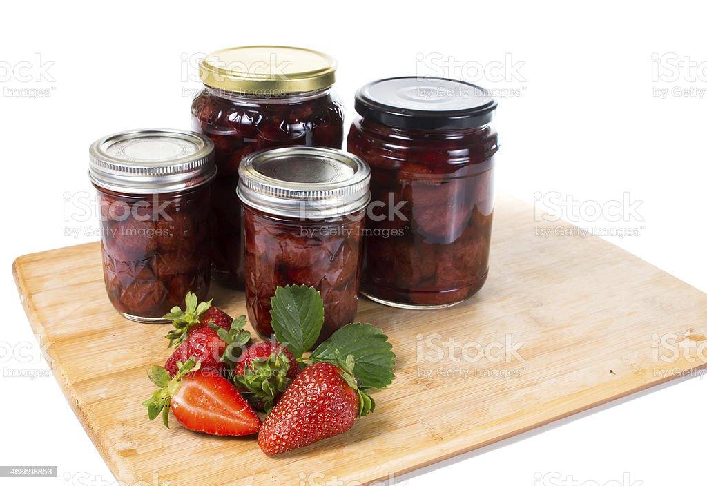 Strawberry jam in a glass jar stock photo