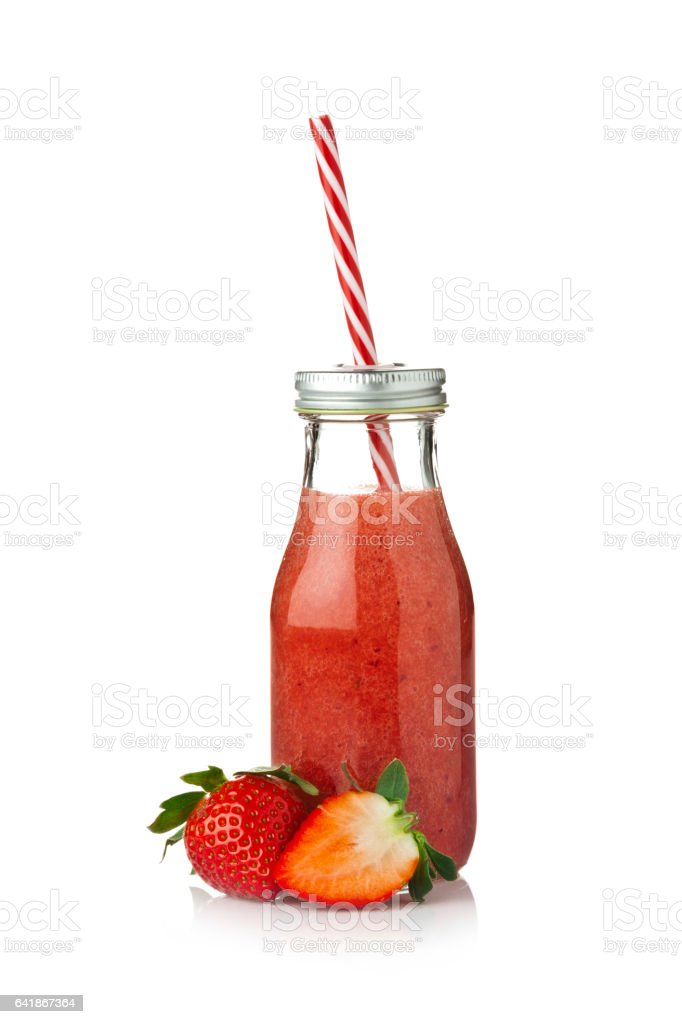 Strawberry juice in a bottle isolated on white background stock photo