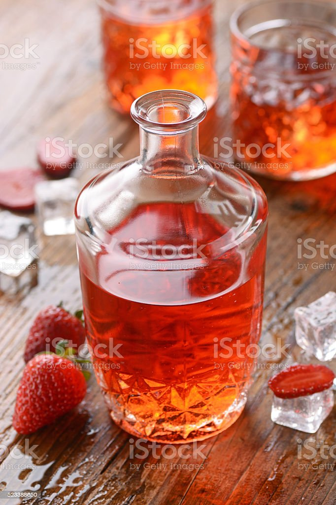 strawberry liqueur on the table stock photo