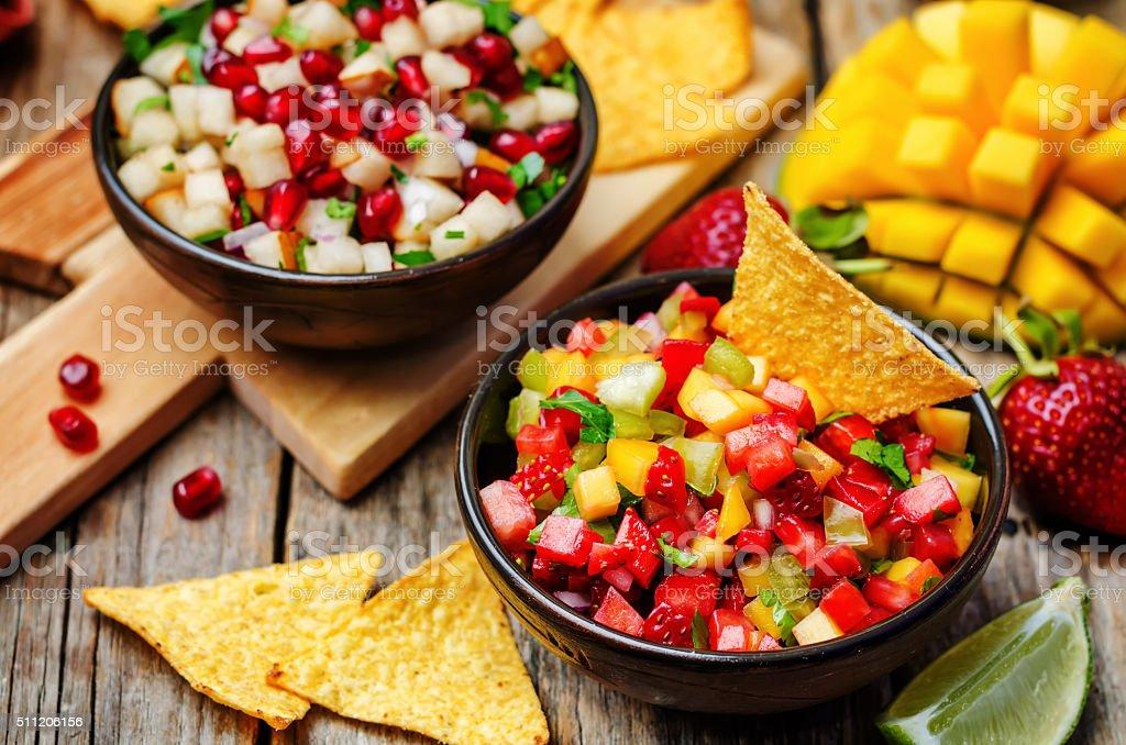 strawberry mango pepper and pomegranate pear salsa stock photo
