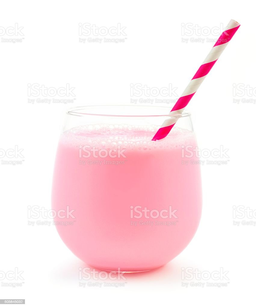 Strawberry milk in a glass tumbler with straw over white stock photo