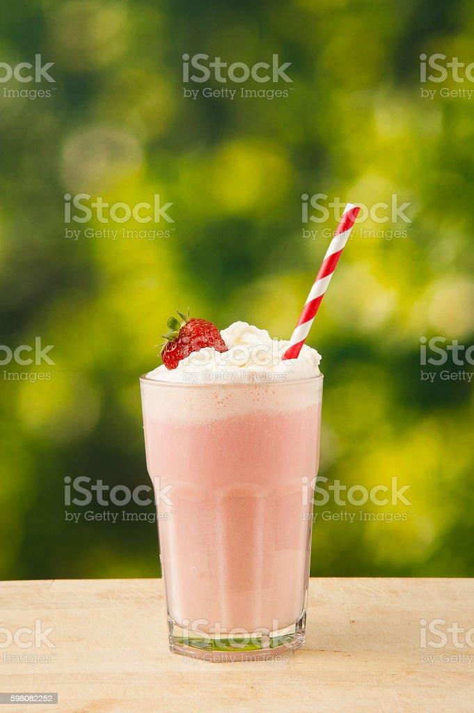 Strawberry Milkshake on wooden table stock photo