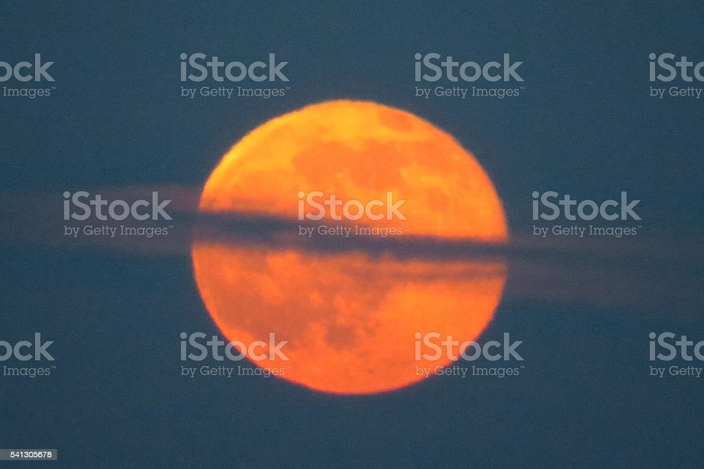 Strawberry Moon in Clouds stock photo