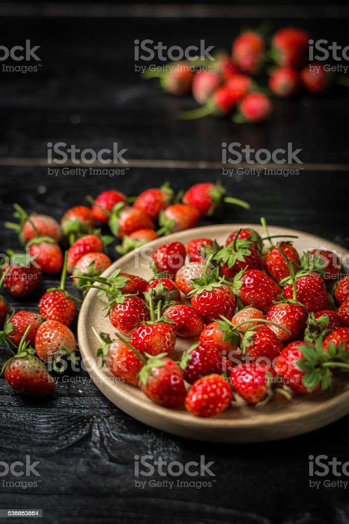 Strawberry on a black wood royalty-free stock photo