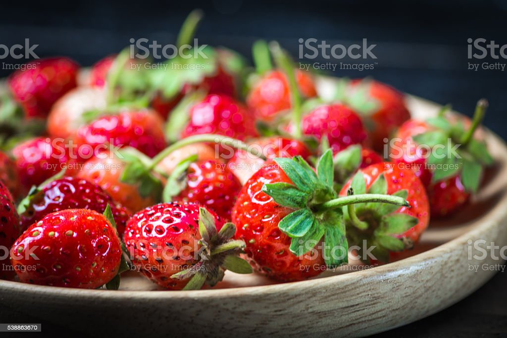 Strawberry on a wooden plate royalty-free stock photo