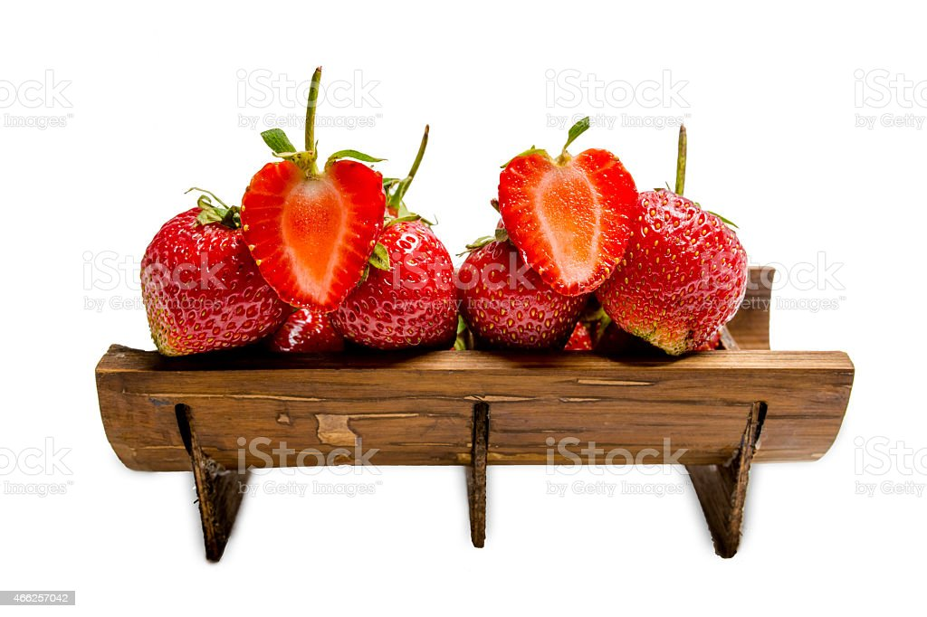 strawberry on bamboo cup stock photo