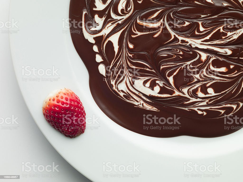 Strawberry on bowl of melted chocolate royalty-free stock photo
